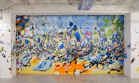 Designed by Gensler, the 55,000-sq.-ft. warehouse-like space features murals by local artists.