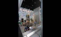 The dramatic 9/11 Gallery is dominated by a piece of the antenna from the World Trade Center, surrounded by a wall of newspaper covers from September 12, 2001, and a ghostlike projection of poignant images from the day.