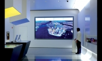 Users can also broadcast their itineraries via a Google Earth flythrough projected on a huge video wall at the back of the store. (Photo: Albert Vecerka/Esto)