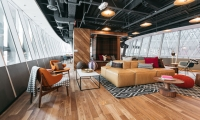 WeWork designed this coworking space in New York City specifically for collaboration, transforming the office building to act like dynamic communities, where entrepreneurs and creatives can mingle and network.