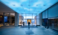 The entry ceiling is low-res LED panels that change color in response to local weather.