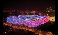 By night, Beijing's National Aquatics Center performs much like an architectural-scaled film projection surface. (Design: PTW Architects)
