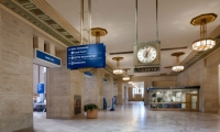Inside, the wayfinding program meets the needs of 21st century commuters, but with respect for the structure.