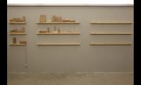 The empty shelf invites future giving.