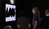 An interactive flat-screen analyzes the sound from the surroundings and shows different shapes based on sound frequency.