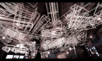 3-D radicals were made by bending metal poles into different angles, shapes and sizes; they are scattered and overlapping randomly but elegantly, creating a surreal and dreamy atmosphere.