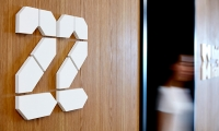 Branding and level identification signage were created out of materials from the architectural build and the line work of the feature wall was engraved into a timber wall cladding.