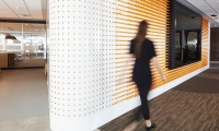 A series of digital screens are flanked with extruded rubber rods in a vibrant orange color—echoing the bank's distinctive branding.
