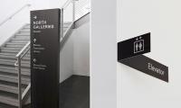 Tacoma Art Museum interior directional signage.