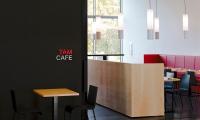 TAM Cafe signage.
