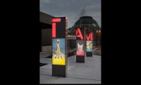 Tacoma Art Museum street-front illuminated event kiosks.