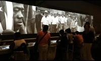 As visitors interact, content is reflected back through the film projected above the exhibit.