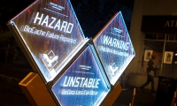 The laser-etched acrylic signs were edge-lit with LEDs.