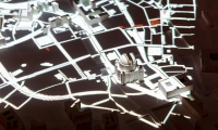 The video map illustrates the expropriation of homes and businesses in Berlin, detailing the properties in context with aerial views of the city center from 1933 to present day.