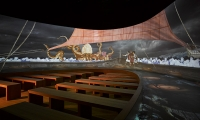 """All Aboard!"" is a fully-immersive, 270-degree cinema, shaped like the prow of a boat."