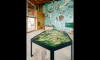 Get oriented. Feel inspired. And get out there! A sculptural topographic map and information desk with a mural of some of the many activities available at the Summit get visitors situated.