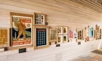 The perimeter walls of the space display a collection of rare Scout ephemera such as posters, pins and patches. Twelve specially designed posters of each tenant of the Scout Law organize the display.