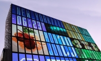 The CUBE has a square façade, spanning 10 stories, that is fully covered with LED displays.