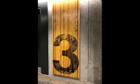 Environmental graphics are an important story-building component in a building that is in itself a landmark; it's the first all-timber building of seven stories to be built in the United States in over 100 years.