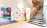 Made of cascading hand-woven scarves and colorful patterned window displays that entice visitors inside, the entry hallway introduces visitors to the current state of the fashion industry and the challenges it poses.
