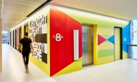 By wrapping elevators in a distinctive design, the design team used the elevators as navigation devices to help staff orient themselves within the building.