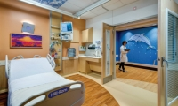 Art in patient rooms continues the universe theme by focusing on bright, cheerful sky views. (Art: Jeannine Dostal. Art Partner: Artworks. Architecture/Interior Design: HKS Architects, GBBN Architects)