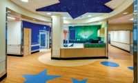 The universe theme continues in ceiling and flooring elements as well as photographic murals at the nurses' stations. (Architecture/Interior Design: HKS Architects, GBBN Architects. Environmental Graphics: Kolar Design)