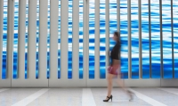 """The 3,000-square-foot, 16,000-pixel-wide digital canvas formed by 89 individual vertical LED """"blades"""" of varying heights."""
