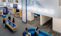 Hanging aluminum-framed scrims and lightboxes of varying shapes and sizes throughout the space reveal the university's mission and tagline, and provide snapshots of student life.