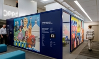 Yiqiao Wang's brightly colored commissioned artwork has been printed on fabric that wraps the exterior of the conference room.