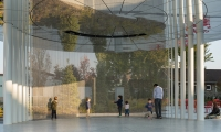 Close-up of water-wall and reflection showing public engagement with the work.