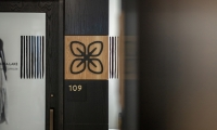 Staff choose *adinkra* symbols that represented their roles within the organization. These symbol panels appear at their office, and are designed to be transferable.