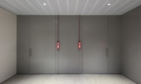 Illuminated meeting room signage featuring LED modules held in aluminum extrusions suspended on tensile wires. (image: red lit signs)