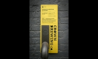 Wall mounted graphic (image: yellow and black metal plaque)