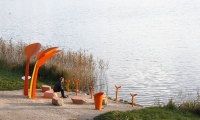 Angler's Seats (image: man fishes from orange bench)