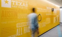Notable lyrics from songs about Texas or by Texas artists were masked and painted onto a pass-through wall in the building's core, then punctuated with dimensional artifacts.