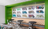 An homage to Austin's long-running affinity for food trucks, the quilted stainless wall in this break room hosts acrylic trucks painted by 15 local artists, all curated and managed by our team.