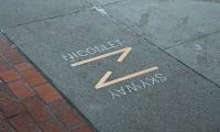 Nicollet (image: Nicollet logo embedded in concrete sidewalk)