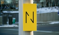 Nicollet (image: bright yellow wayfinding signs with Nicollet N logo)