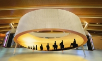 A 360 immersive experience which follows a group of Cossacks from the early 1700s across the Russian Steppe. (image: large 360-degree screen in airport)