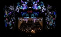 Grand Fanale - last movement. Photo taken during live performance from upper balcony. (image: colorful projections in theater)