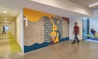 Ground floor artwork in the tšɨłkukunɨtš, (Carrizo Plains) building is the story of the rabbit's den (image: large artwork of rabbit on concrete wall)
