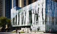Interface Inc.'s new headquarters features a complex photomosaic façade – a pixelated image of a forest scene comprised of 307 panels sheathed in recyclable polyester. (Day)