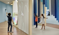 Live cameras capture children's movement on a two-sided wall surface. The human form is abstracted as a line, but when two kids' outlines on the projection meet, intersecting patterns occur. (image: kids interact with exhibition)