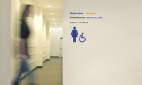 """For """"a Fortune 100 company involved in Internet commerce,"""" Michael Courtney Design created graphics in numerous buildings on the campus. Here, a bathroom is signed with an Internet in-joke."""