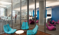 A reading lounge dedicated to teens is identified by window graphics.