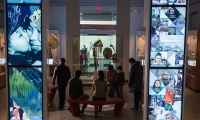 """Each tower has a motion sensor, transitioning smoothly from the full-screen """"attract"""" animation to a personalized, touch-driven experience that engages the user while beckoning visitors across the gallery with big, bold imagery."""