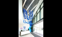 Inside the lobby, the Unilever brand mark gets sculptural.