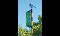 Visual Asylum created a family of bird characters that appear on digitally printed aluminum banner blades and on waterjet-cut sculptural elements atop banner poles.