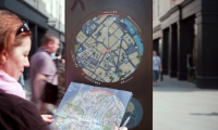 The system is augmented by handheld printed maps, which are available at shops, city information points, and hotels.
